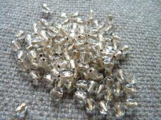 csiszolt gyöngy 4 mm bronz közepű kristály 50 db