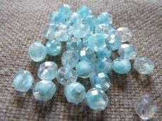 csiszolt gyöngy 8 mm: kristály-kék hematit bevonattal 20 db