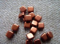 Dupla lyukú préselt négyzet matt red-bronze 20 db