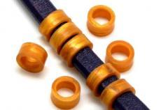 gumi köztes ovális bőrhöz szélesebb arany 2 db