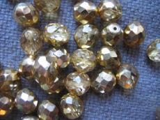 csiszolt gyöngy 10 mm kristály arany bevonattal 5 db