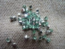 sw bicone 4 mm chrysolite CAL Xilion