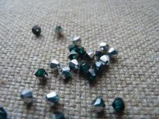 sw bicone 4 mm emerald CAL Xilion