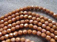 csiszolt gyöngy 6 mm fehér-barna-arany travertin 25 db